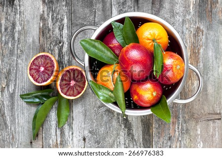 Blood orange fruit on wooden table. Top view - stock photo