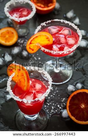 Blood Orange Margarita in glass with salted rim - stock photo