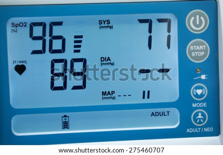 Blood pressure displayed on monitor close-up. - stock photo