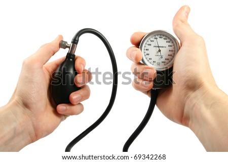 blood pressure gauge in the hands - stock photo