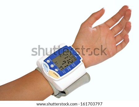 Blood pressure measurement with wrist automatic monitor - stock photo