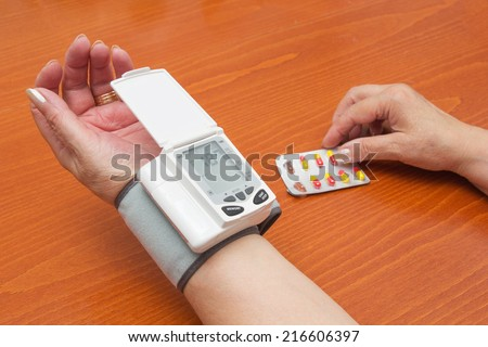 Blood Pressure Meter on Adult Woman Wrist. - stock photo