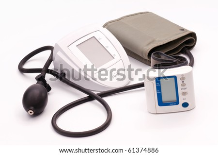 Blood-pressure meter on white the table - stock photo