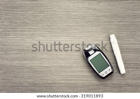 Blood sugar measurement, Diabetic kit, Syringe pen with insulin and glucometer, Blood glucose test, Blood glucose meter kit. (Vintage Style Color) - stock photo