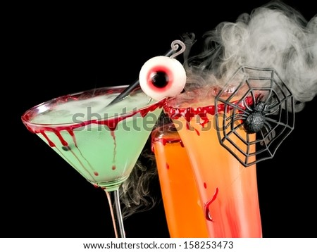Bloody Halloween cocktails with smoke, close up - stock photo
