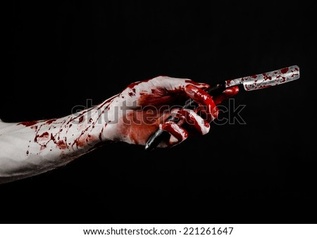 Bloody hand holds a razor, an old razor, dangerous blade, bloody razor, a maniac with a razor, a bloody knife, mad barber, black background, isolated, bloody topic, zombie theme, halloween theme - stock photo