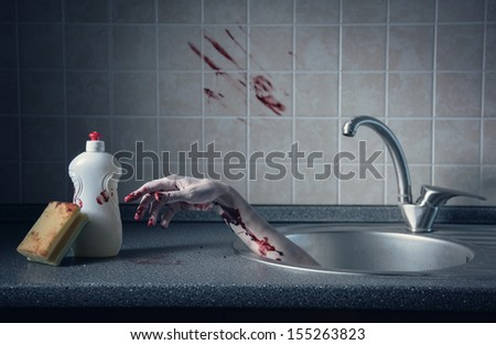 Bloody hand in kitchen sink, Halloween concept or crime scene  - stock photo
