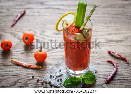 Bloody Mary cocktail on the wooden background - stock photo