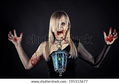 bloody vampire with a lantern in the neck - stock photo