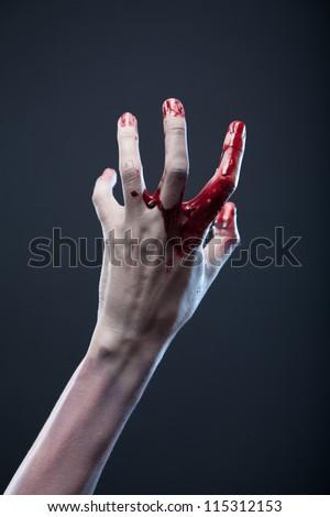 Bloody zombie hand, extreme body-art, studio shot - stock photo