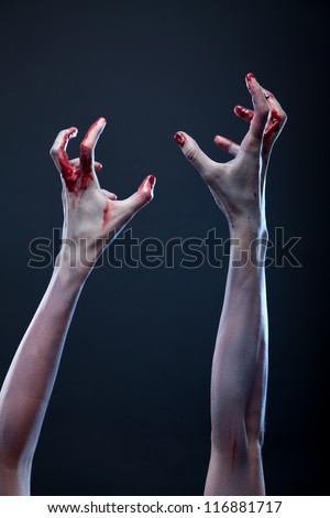 Bloody zombie hands, Halloween theme - stock photo