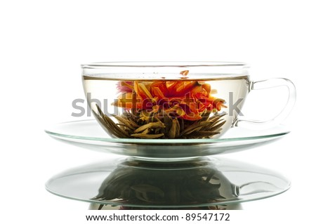 blooming tea in glass cup - stock photo