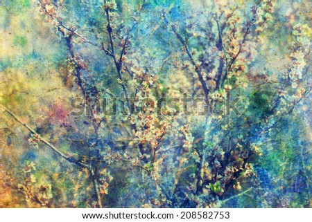 Blooming twigs and grunge messy watercolor splatter  - stock photo