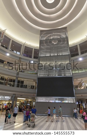 BLOOMINGTON, MN - JULY 06,  - Mall of America on July 06, 2013  in Minnesota. The Mall of America has a gross area of 4,200,000 sq ft or 96.4 acres, enough to fit seven Yankee Stadiums inside. - stock photo