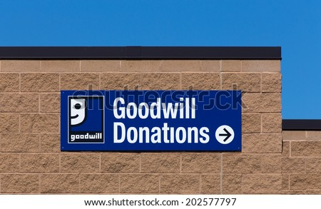 BLOOMINGTON, MN/USA - JUNE 21, 2014:  Goodwill store exterior sign. Goodwill Industries is a nonprofit organization that provides job training programs for people with disabilities. - stock photo