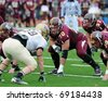 BLOOMSBURG, PA - NOVEMBER 6: Bloomsburg University offensive lineman Daryl Kurtz (#70) shown in a three point stance waiting for a snap in a football game November 6, 2010 in Bloomsburg, PA - stock photo