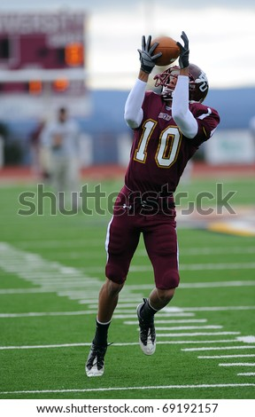 BLOOMSBURG, PA - NOVEMBER 6: Bloomsburg University wide receiver Sellus Roulhac (#10) catches a pass prior to a football game November 6, 2010 in Bloomsburg, PA - stock photo