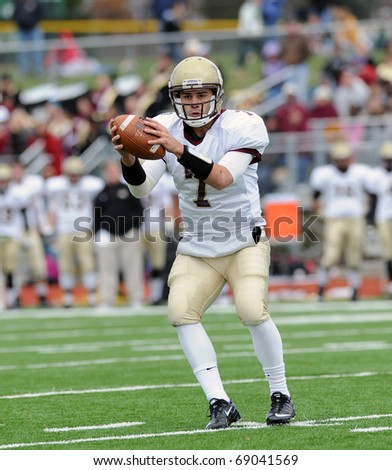 BLOOMSBURG, PA - NOVEMBER 6: Kutztown University quarterback Kevin Morton gathers in a snap in the shotgun during a game on November 6, 2010 in Bloomsburg, PA - stock photo
