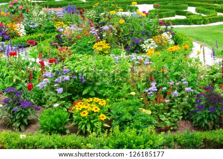 Blossoming flowerbeds in the park - stock photo