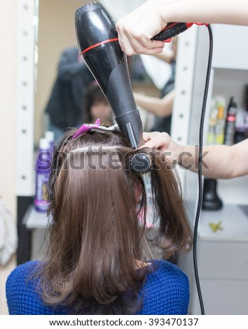 blow-drying in a beauty salon - stock photo