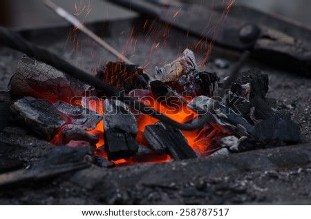 blow on the coals, with motion blur (smith) - stock photo