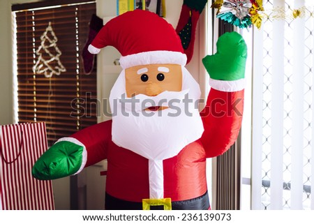 Blow up Santa in living room - stock photo