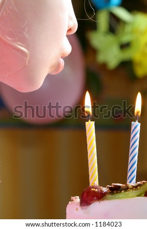 Blowing birthday candles - stock photo