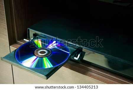 Blu-ray player with inserted disc - stock photo