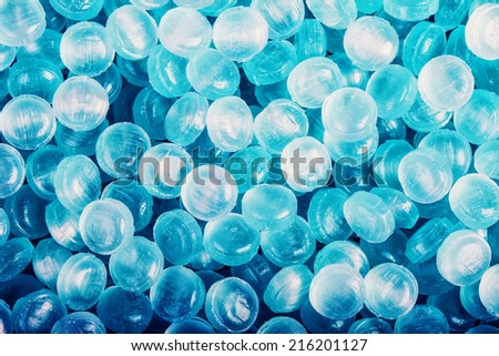 Blue abstract background or texture of sweets and menthol candies - stock photo