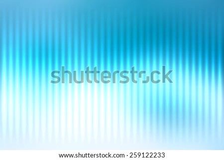 Blue abstract blur colored background with defocused vertical rays of light. - stock photo