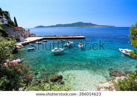 blue adriatric coast with boats - stock photo