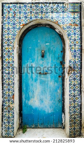 Blue aged door with ornament and tiles from Sidi Bou Said in Tunisia. Large resolution - stock photo