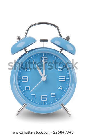 Blue alarm clock with the hands at 11 am or pm isolated on a white background, One of a set of 12 images showing the top of the hour starting with 1 am / pm and going through all 12 hours - stock photo