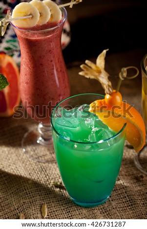 Blue Alcohol Cocktail with Orange Slice - stock photo