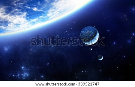 blue alien Earth like planet with inhabited moons - stock photo