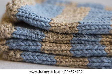 blue and beige knitted shower gift for baby boy - stock photo
