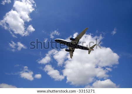 Blue and cloudy sky and airliner - stock photo