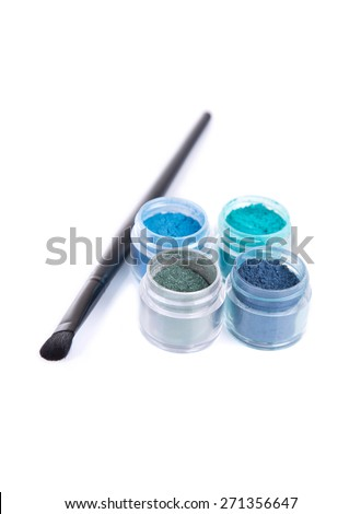 Blue and green eye shadows with make-up brush, isolated on white background  - stock photo