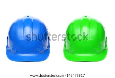 Blue and green hard hats - stock photo