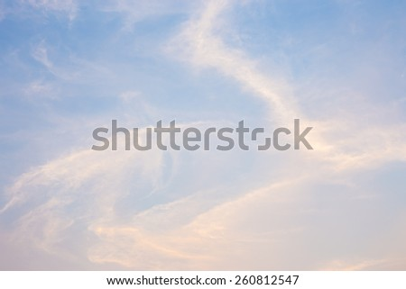 Blue and orange sky with dragon  clouds background. - stock photo