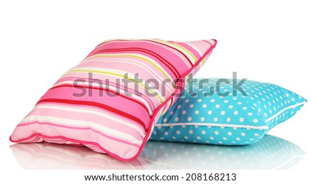 Blue and pink bright pillows isolated on white - stock photo