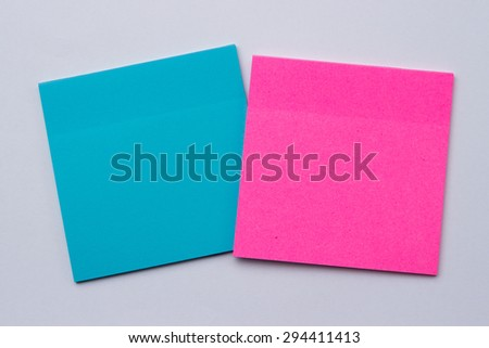 blue and pink reminder sticky note on white background - stock photo