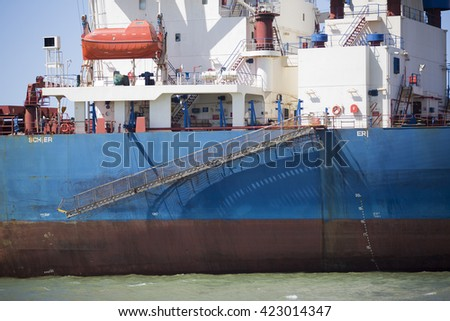 Blue and red bulk ore carrier - stock photo