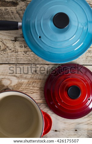 Blue and red open saucepans - stock photo