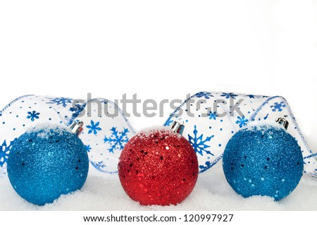 Blue and red ribbon and ornaments on white background - stock photo
