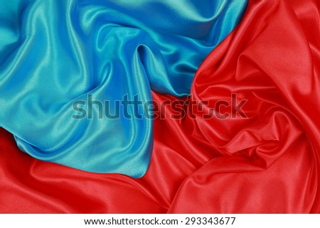Blue and red Silk cloth of abstract backgrounds or wavy folds or satiny silk texture satin velvet material or elegant wallpaper design curve. - stock photo