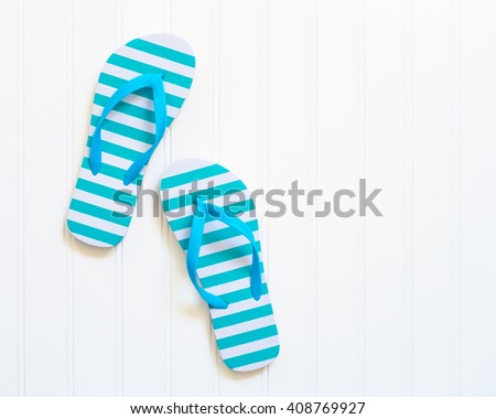 Blue and white beach sandals commonly call flip flops. - stock photo