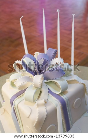 Blue and white cake with candles at bat mitzvah - stock photo
