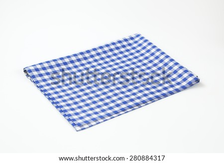 blue and white checkered tablecloth on white background - stock photo