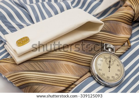 Blue and white cotton shirt, old Stopwatch and orange tie, time pressure concept - stock photo